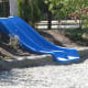 Some natural playgrounds contain slides, but the slides are built into a slope to make them safer.