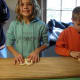 Kids learn what it was like to fold pretzels by hand