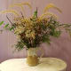 Use dried grasses, weeds, seed pods, rose hips and evergreen shrubbery to make a bouquet.