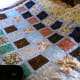 This is intended to be a boy's quilt, so is not too complicated or floral-looking. The muted blues should work well in almost any room, while there is sufficient interest in the deeper tones.