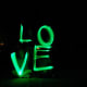"Taking a picture while spelling ""love""  with glow sticks."