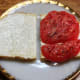 Tomato sandwich made with Duke's mayo on sourdough bread