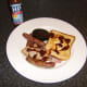 HP Sauce is an optional addition to the leg of pork mixed grill