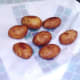 Deep fried potatoes are drained on kitchen paper