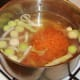 Prepared vegetables are added to chicken stock