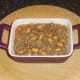 Beef and bean combination is added to baking dish.