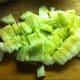 Peeled and chopped cucumbers.