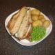 Potatoes and peas are plated alongside the Arbroath smokie