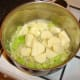 Potatoes are added to the softened onion and celery