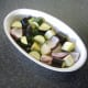 Season vegetables and stir in olive oil before roasting