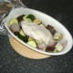 Remove stuffed chicken breast and vegetables from oven