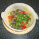 Add chopped coriander (cilantro) to the casseroled vegetables
