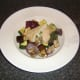 Serve stuffed chicken breast on a bed of roasted Mediterranean vegetables