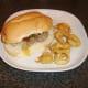 Burger style pork leg and salsa steak sandwich with onion rings