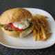 Burger style steak, salad and garlic mayo sandwich with fries
