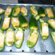 Lay the Stuffed Jalapeno Pepper halves in a single layer on the broiler tray of my convection oven. Drizzel garlic infused olice oil over peppers and sprinkle top with parmesan cheese.