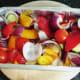 Mediterranean vegetables are seasoned and prepared for roasting