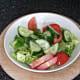 Salad is seasoned with salt, pepper and lemon juice