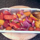 Oiling and seasoning vegetables for roasting