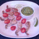 Tomato halves and lime wedges are arranged on the serving plate