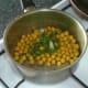 Coriander leaf/cilantro and garlic are added to chickpeas