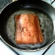 Salmon is added to frying pan