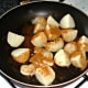 Potatoes and onion are seasoned with curry powder