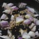 Step two: Saute cumin seeds in butter. Add chopped onions. Stir-fry till they become transparent.