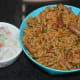 Step ten: Serve hot spinach rice with cucumber-onion raita or any other yogurt-based raita. Happy eating!
