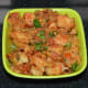 Serve the spicy tava idli in a serving bowl or plate. Garnish with finely chopped coriander leaves. Enjoy!