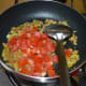Add the chopped tomatoes and stir-cook them until they become mushy.