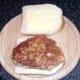 Chicken schnitzel on bread