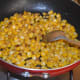 Step three: Throw in corn kernels and some salt. Stir-cook for 3-4 minutes. Now, the corn becomes soft, yet retains crunchiness.