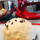 Transfer the dough onto a floured surface/baking mat. Shape the dough into a ball.