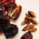 Remove the pits from the dates before chopping them.