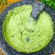 Add in the avocado pulp and again mash it until it is creamy with very few lumps.