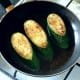 Spiced zucchini or courgette wedges are quickly fried