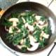 Spinach is arranged around sauteed mushroom slices