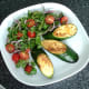 Plated zucchini wedges and salad