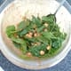 Spinach is stirred in to chickpeas in tomato sauce