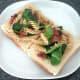 Infused fusilli pasta is arranged on toast