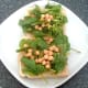 Chickpeas and spinach in tomato sauce are arranged on top of toast