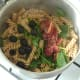 Sun dried tomatoes and black olives are added to pasta