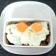 Fried eggs are laid on sardine combination