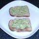 Guacamole is spread on toast