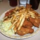 Coleslaw with fried chicken and French fries.