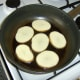 Pan frying the potato slices