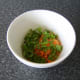 The grated carrot and cilantro/coriander are stirred through some cider vinegar to prevent discolouration.