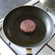 Black pudding is shallow fried in olive oil
