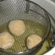 Frozen croquettes placed in deep-fryer set at 350 degrees.